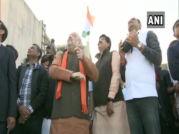 Amit Shah flew kite in Ahmedabad on Tuesday (Photo/ANI)