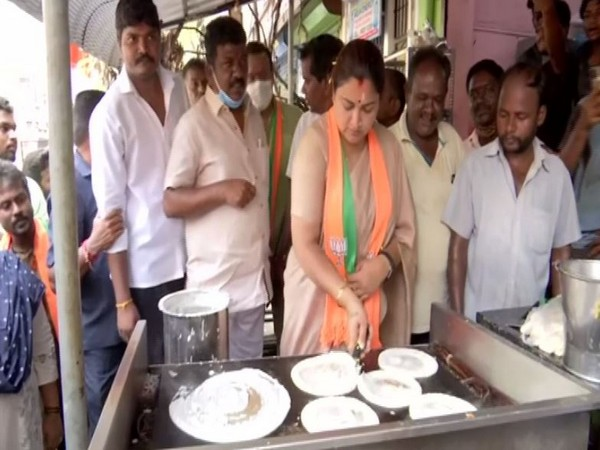 Khushbu Sundar cooking dosas as part of election campaign