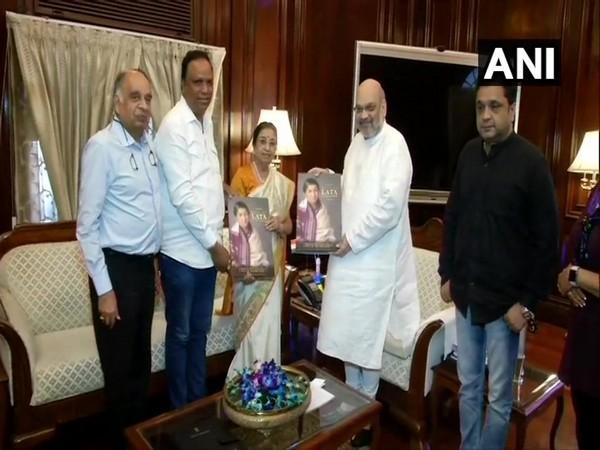 Union Home Minister Lata Mangeshkar releasing