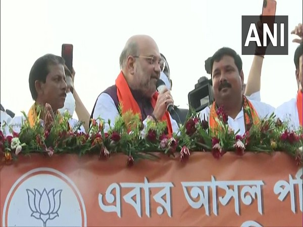 Union Home Minister Amit Shah at a roadshow in West Bengal's Hoogly.