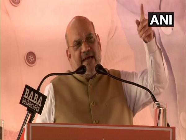 BJP president Amit Shah addressing a rally at Loharu in Haryana on Wednesday. (Photo/ANI)