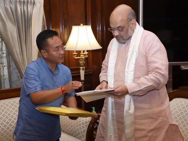 Sikkim Chief Minister Prem Singh Tamang (l) meeting Union Home Minister Amit Shah (r) in New Delhi on Saturday. (Photo/ANI)