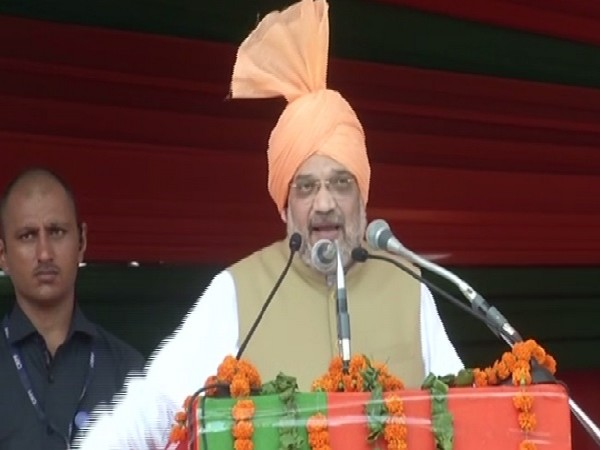 Union Home Minister Amit Shah addressing a rally in Jind.
