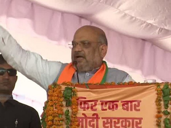 BJP president Amit Shah addressing a election rally at Bharatpur on Tuesday