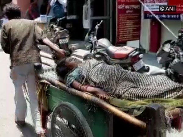 Man driving the woman in cart to hospital in Shamli, Uttar Pradesh.