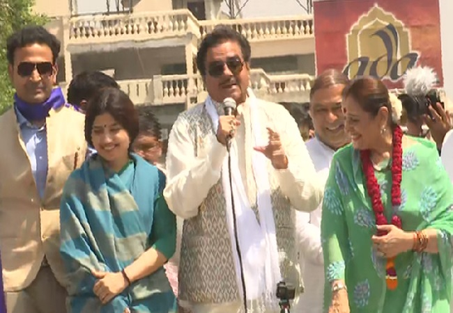 On left SP leader Dimple Yadav, in middle Congress leader Shatrughan Sinha and on right SP leader Poonam Sinha during a road show in Lucknow on Thursday Photo/ANI.