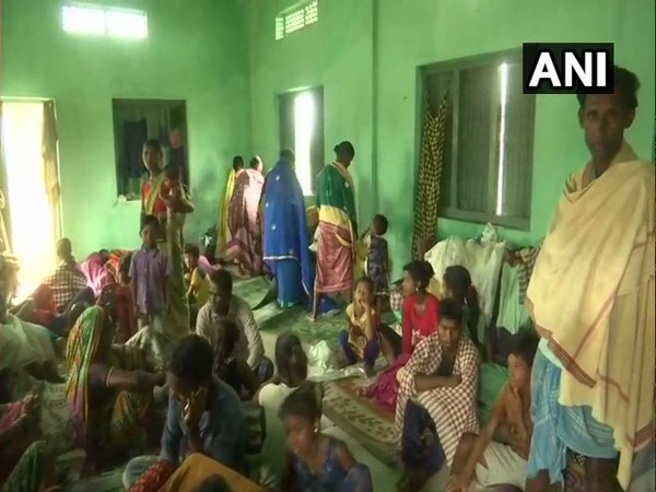 People take refuge in a shelter in Ichchapuram town of Srikakulam district.