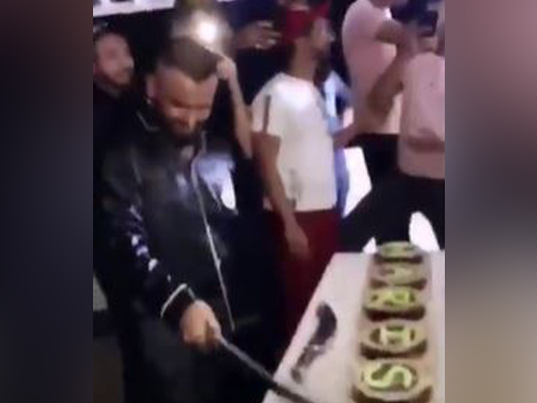 Man cuts cakes with a sword, held. Photo/ANI