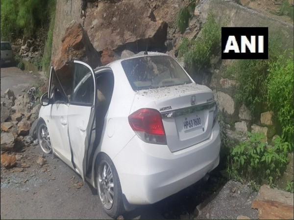 Boulders hit an unoccupied car in Shimla on Thursday. Photo/ANI