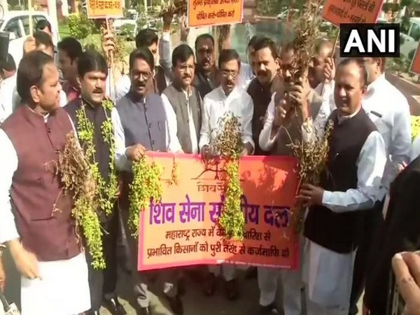 Shiv Sena leaders held a protest on Parliament premises, demanding relief measures for farmers. Photo/ANI