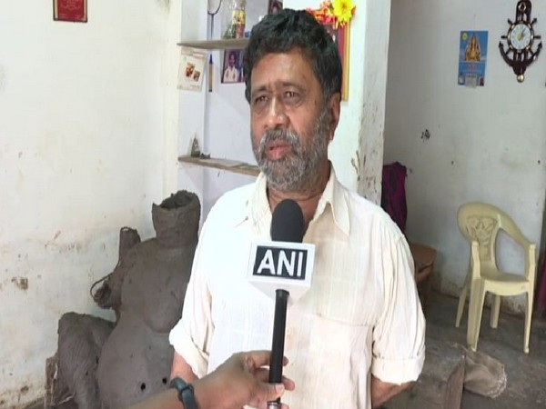 Ganesh, an idol maker of the Kumabara community speaks to ANI after floods in the state washed away his only livelihood on Friday. Photo/ANI