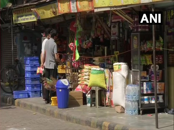 Shop selling essential commodities reopens in Bengali Market on Monday. Photo/ANI