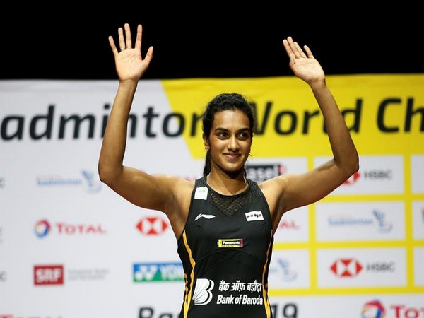 PV Sindhu posing after winning gold at the BWF World Championships.