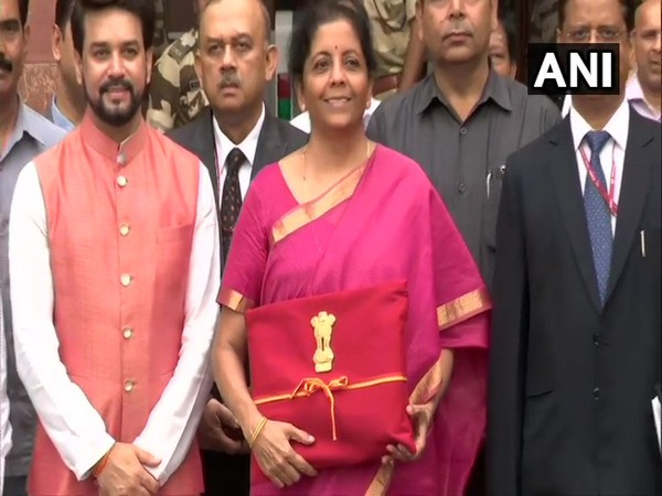Finance Minister Nirmala Sitharaman (middle) and MoS Finance Anurag Thakur (left) were seen outside the Finance Ministry before budget presentation at the Lok Sabha. Photo/ANI