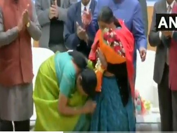 Defence Minister Nirmala Sitharaman touching feet of mother of a braveheart during an event on Monday in Dehradun.