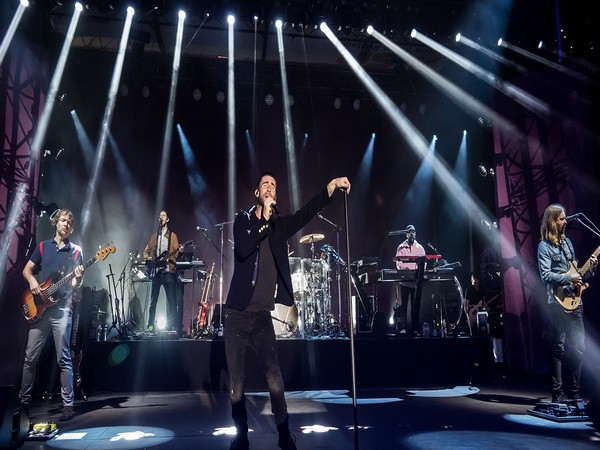 Adam Levine performing with Maroon 5