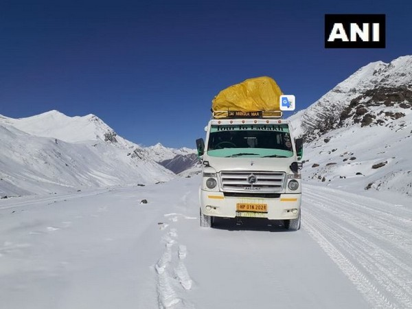 A truck crossing the Baralacha La in Lahaul and Spiti district on Sunday amid snowfall. Photo/ANI