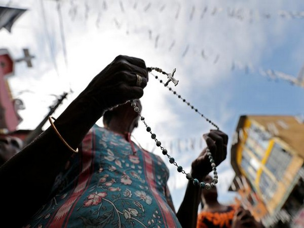 A woman holds a rosary as a tribute to the Easter Sunday terror attack