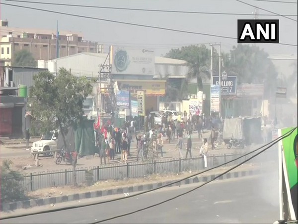 Plumes of smoke were seen at Singhu border (Haryana-Delhi border) as the security personnel used tear gas to disperse farmers protesting on Friday. [Photo/ANI]
