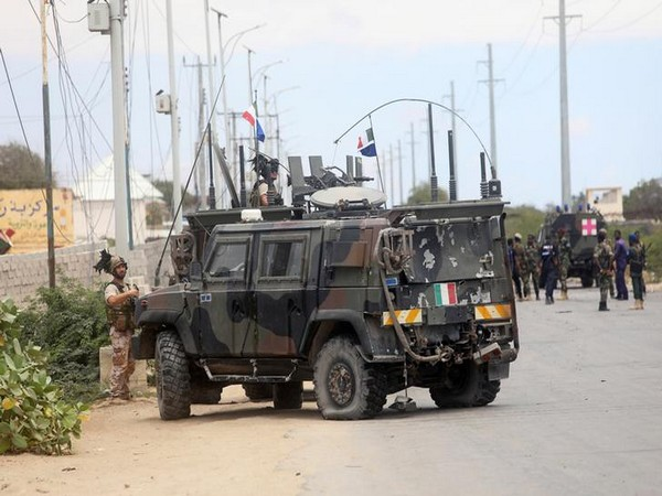 Italian security forces were seen near armoured vehicles at the scene of an attack on an Italian military convoy in Mogadishu, Somalia on Monday
