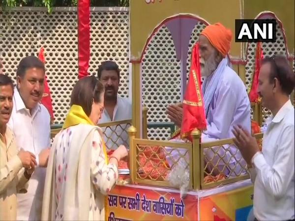 Congress president Sonia Gandhi performing rituals of 'Sobha Yatra' on the occasion of Maharishi Valmiki Jayanti at her residence in New Delhi on Sunday. Photo/ANI