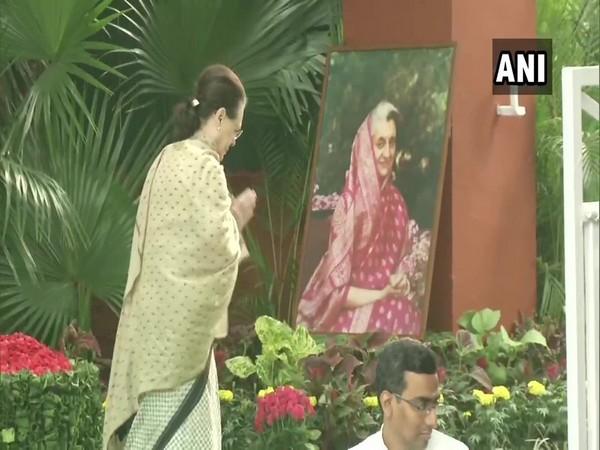 Congress interim president Sonia Gandhi pays tribute to Indira Gandhi in New Delhi on Thursday. Photo/ANI