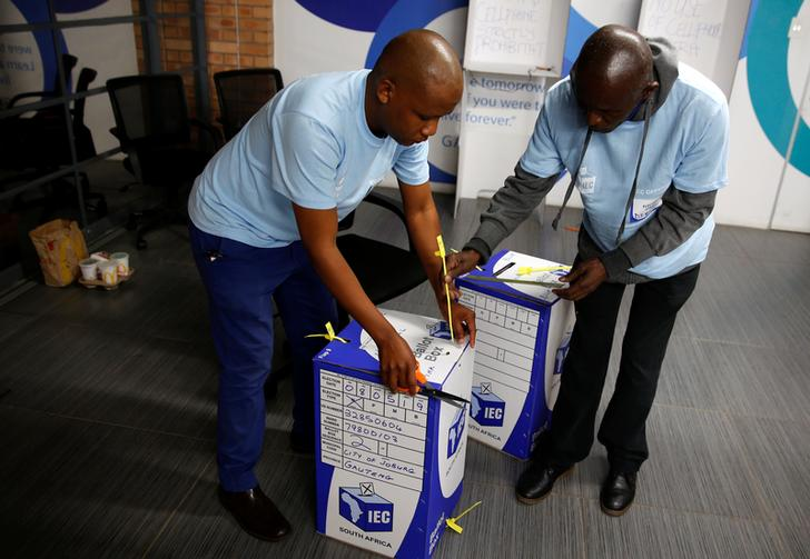 Election officials seal ballot boxes at the end of voting in South Africa's parliamentary and provincial elections on Wednesday. (Photo/Reuters)