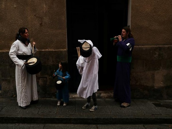 People prepare to play drums outside their home after the Way to the Calvary procession was cancelled due to the coronavirus outbreak in Cuenca, Spain