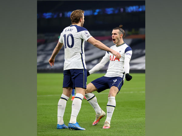 Harry Kane and Gareth Bale celebrating after scoring a goal.