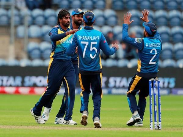 Nuwan Pradeep celebrates after taking a wicket