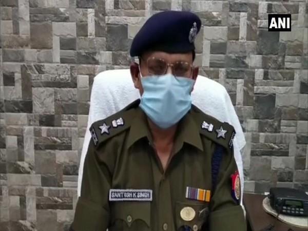 SSP Bulandshahr Santosh Kumar Singh speaking to reporter.