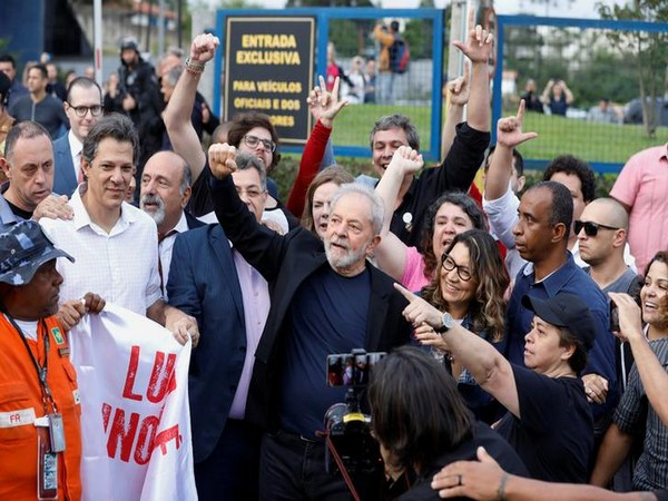 Former Brazilian President Lula da Silva gestures after being released from prison, in Curitiba on Friday
