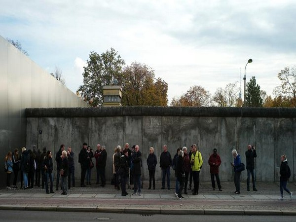 Tourists visit remains of the Berlin Wall at the Wall memorial on Bernauer Strasse in Berlin, Germany on Saturday