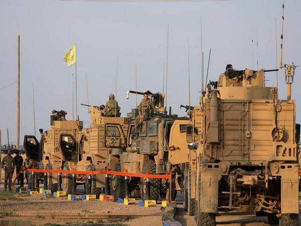 American soldiers stand near military trucks, at al-Omar oil field in Deir Al Zor, Syria back in the month of March (File Photo)