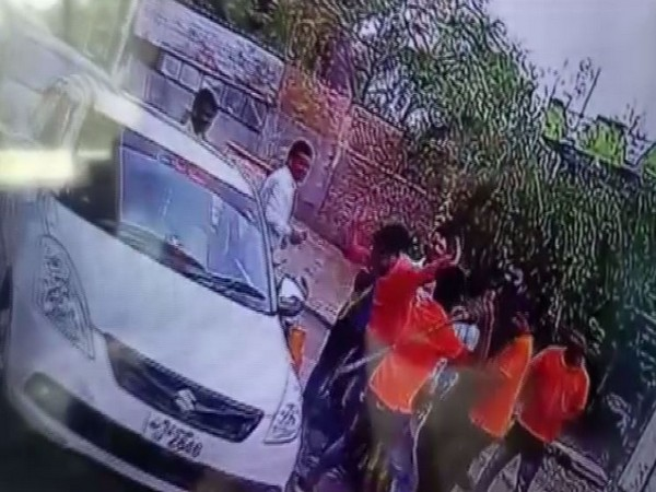 The CCTV camera footage showing toll plaza employees beating up car passengers with sticks. Photo/ANI
