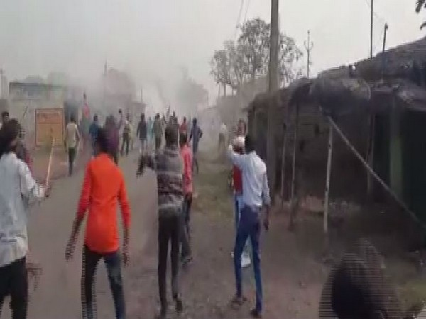 The visuals available from the spot show BJP workers throwing stones and destroying vehicles. (Photo: ANI)