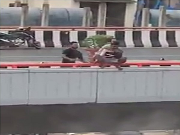 Locals rescue mentally challenged man trying to jump off flyover in Rajendranagar area on Thursday. (Photo/ANI)