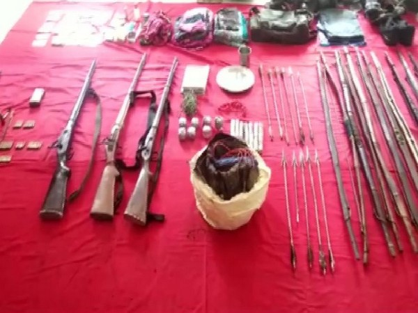 AnINSAS rifle, live cartridges and an IED container recovered from possession of the deceased Naxals in Sukma.