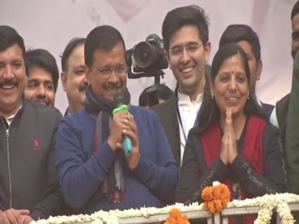 Arvind Kejriwal along with his wife Sunita at AAP office in New Delhi on Tuesday.