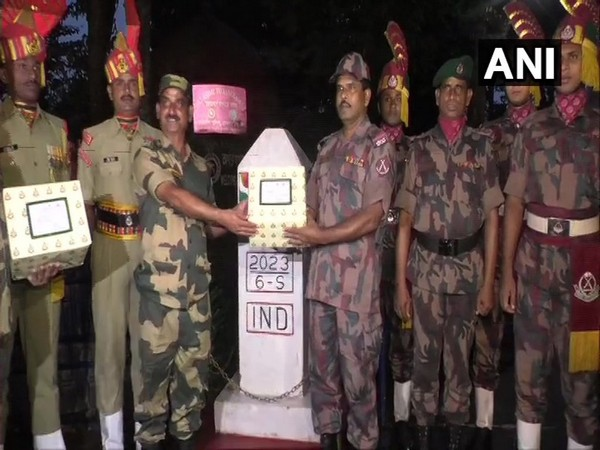 BSF exchanged sweets with BGB at the Akhaura integrated check post on Friday. (Photo/ANI)