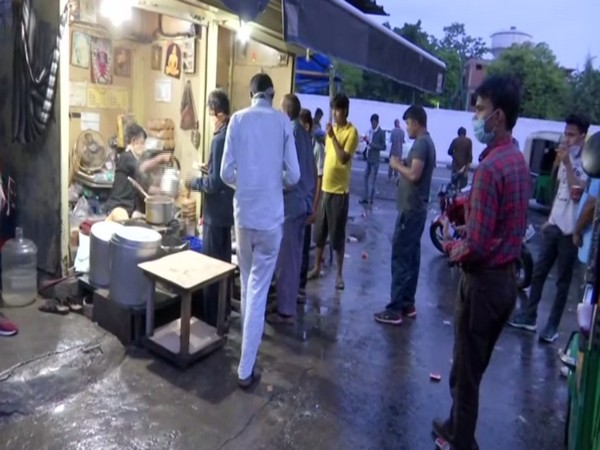 People sipping tea at Minto Road in Delhi on Wednesday morning. [Photo/ANI]