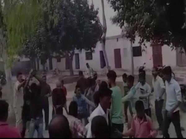 Visuals of students thrashing their teacher in Soraw area in Prayagraj. Photo/ANI