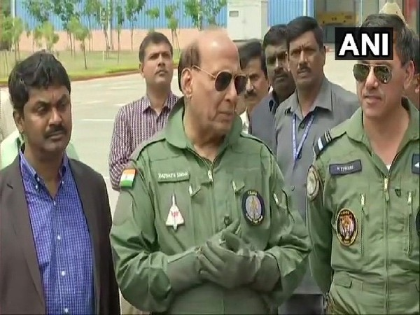 Defence Minister Rajnath Singh speaking to media after finishing 30 minutes sortie in LCA Tejas in Bengaluru on Thursday.