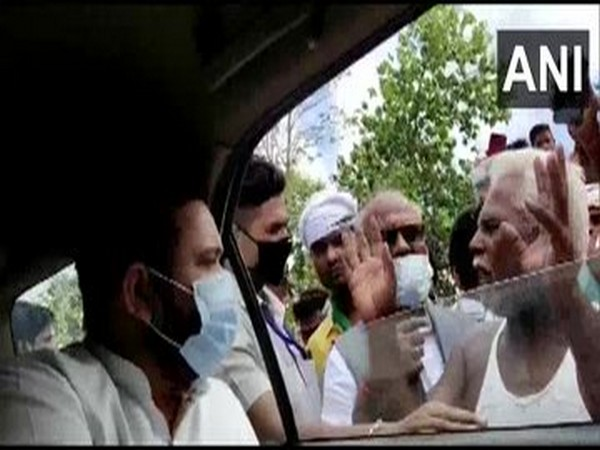 RJD leader Tejashwi Yadav interacting with flood affected people in Bihar on Sunday.