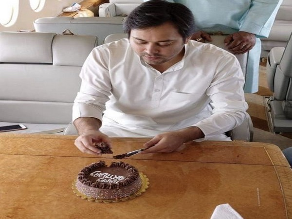 RJD) leader Tejashwi Yadav shared his picture cutting cake on charted plane on his birthday