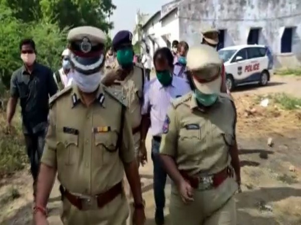 Telangana Police inspecting the site where four members of a family were found dead in a well. Photo/ANI