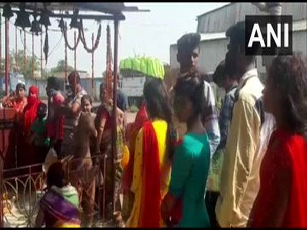 People were seen without masks at the temple in Durgapur.