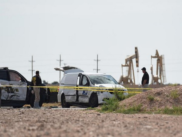 Officials investigate the stolen mail truck used by the shooter in West Texas on Saturday