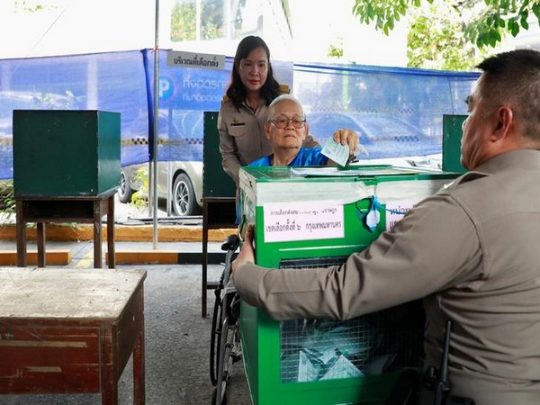 A voter casts ballot at a polling station in Bangkok, Thailand