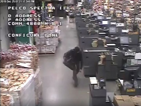 The Auburn police department recently released CCTV footage of the bogeyman on Facebook, who can be seen walking past a line of cash counters (Picture Courtesy: Facebook)